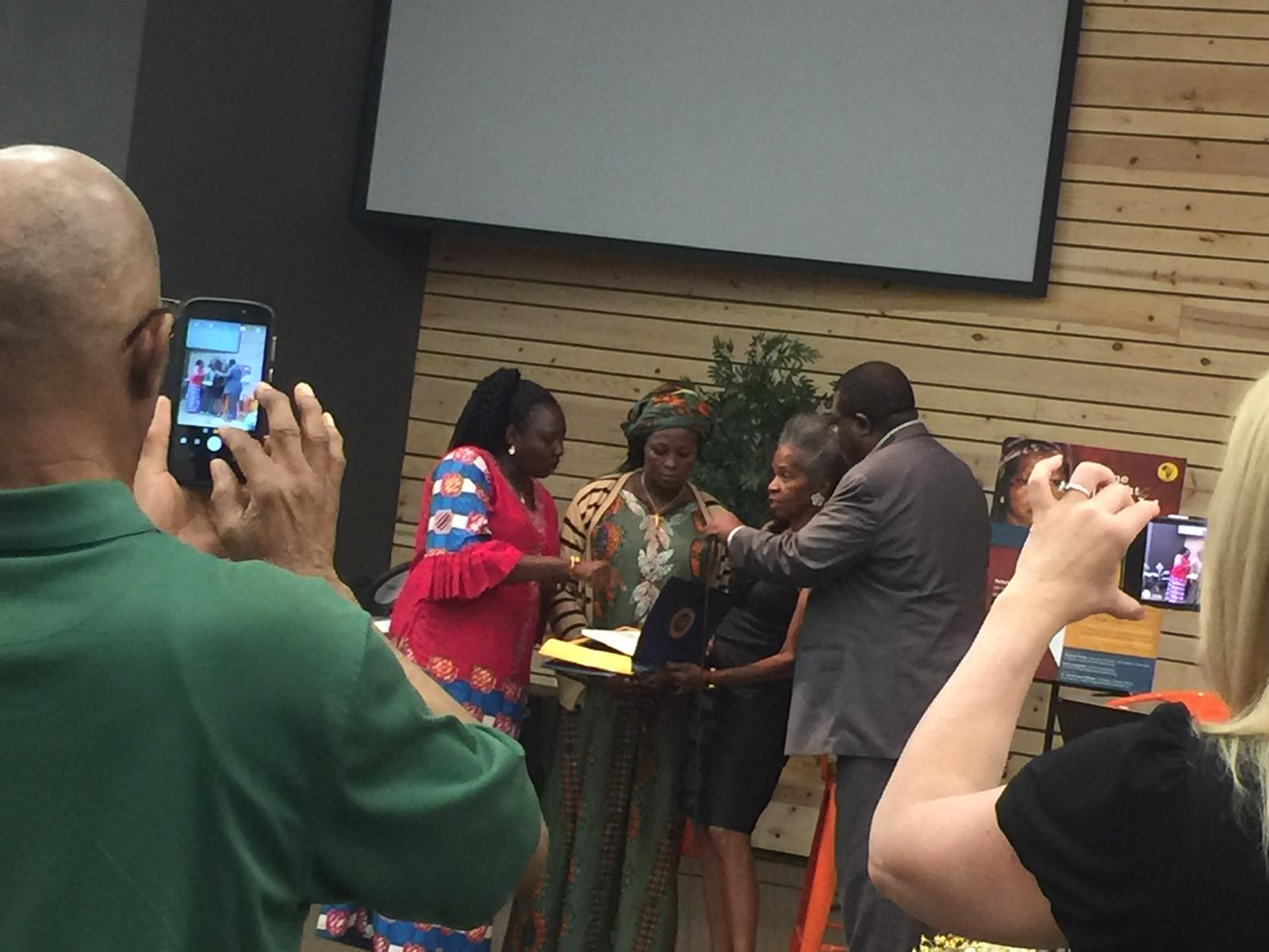 Veteran Journalist, Dr Esther Davis Presenting Citation from the Mayor of Dallas to Rebekah Shuaribu and her Team